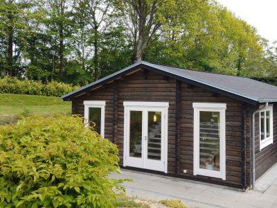 Specialdesignet bjælkehus til haven fåes hos www.sølundhuse.dk find din bjælkehytte til haven